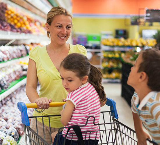 Woman in supermarket with children
